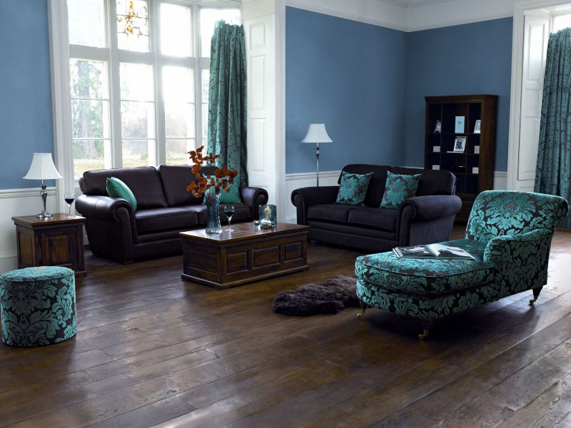Clean up dirt and scratches on floor and tables. Paste in hanging lamp into image from image B. Smoothen out tops of leather sofas. Remove blue block on wall next to left window. Repair tear in left plain blue cushion on sofa. Extend right curtains down to floor and remove piano.