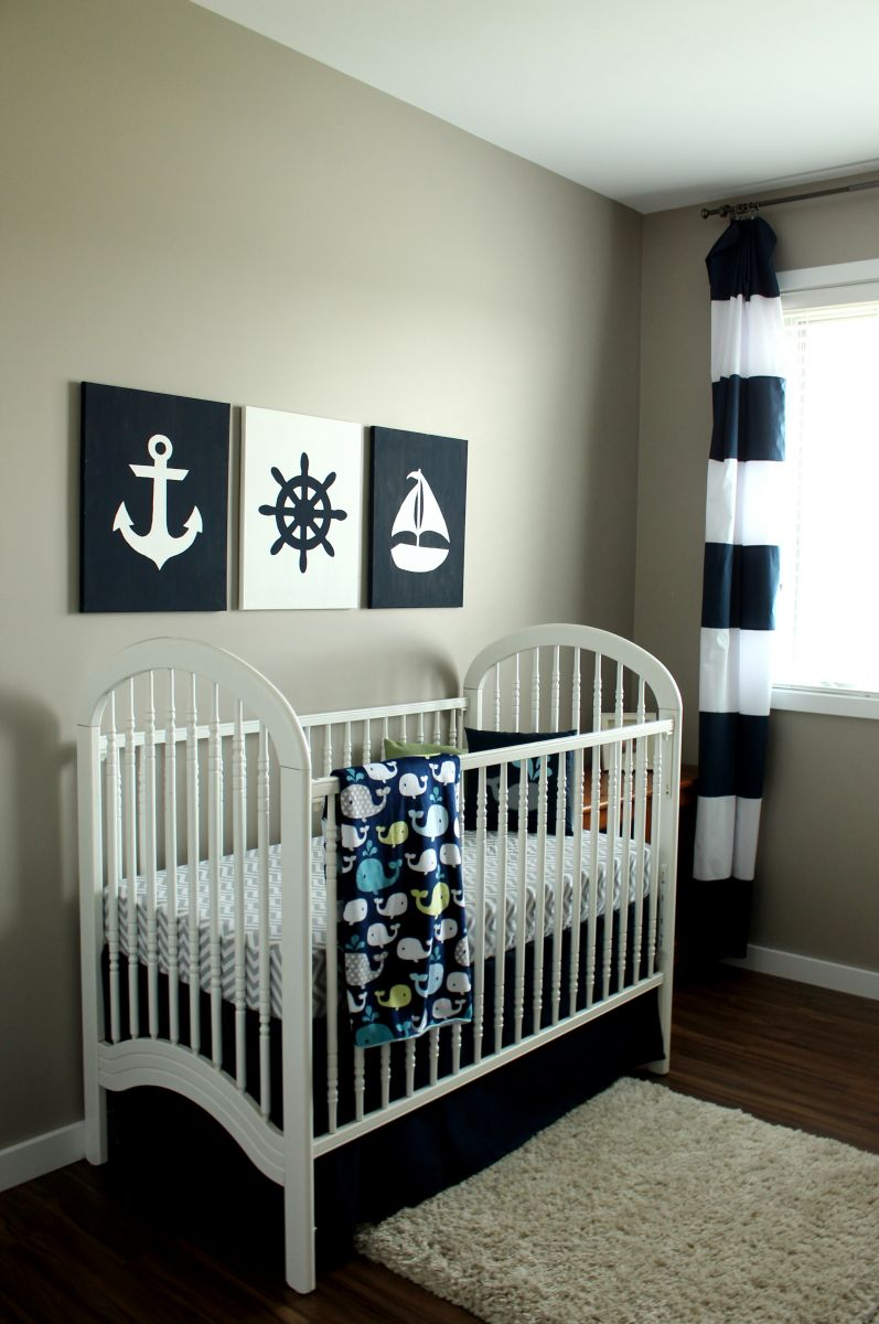 baby-room-light-grey-wall-frames-anchor-stained-white-wood-bedding-lines-black-white-curtains-fishes-pattern-blanket-pirate-baby-nursery