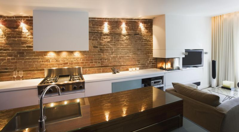 pretty-kitchen-design-with-natural-brick-wall-and-white-furniture-color-also-glass