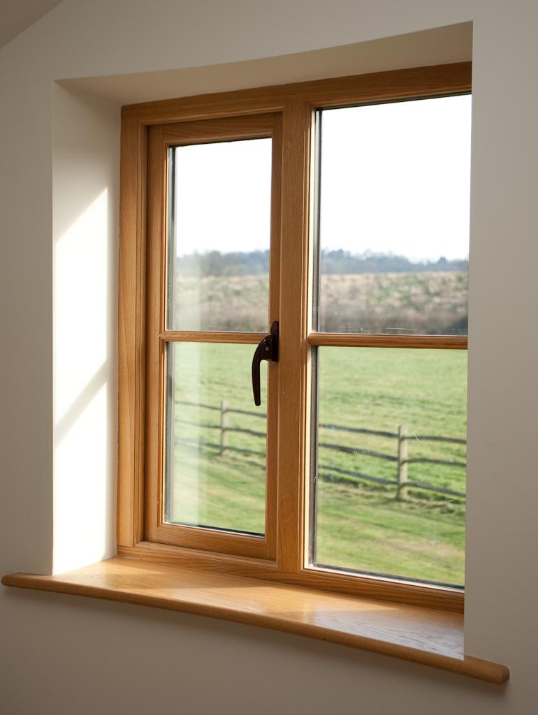 stormproof-oak-window-with-curved-window-board