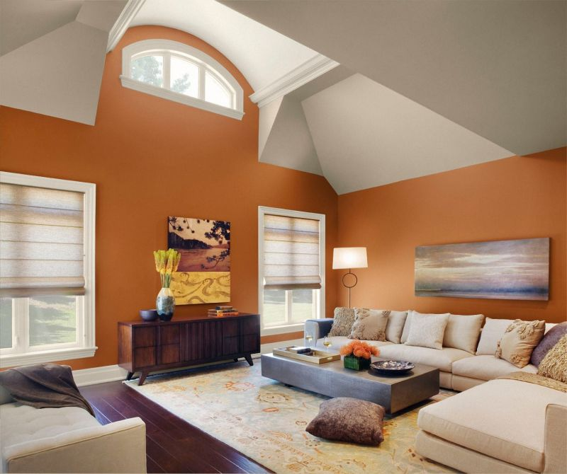living-room-orange-wall-painting-mixed-with-a-couple-of-square-peach-painting-country-living-room