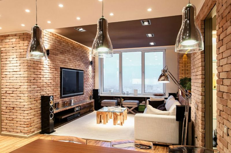 nice-exposed-brick-wall-design-of-apartment-living-room-with-interesting-lights-decor-and-white-fabric-couch-also-square-glass-coffee-table-on-white-carpet-floor-1120x744