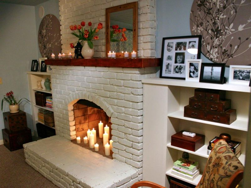 nice-warm-decorating-ideas-for-a-brick-fireplace-mantel-that-has-white-wall-and-white-shelves-make-it-seems-great-design-inside-room-with-warm-lighting
